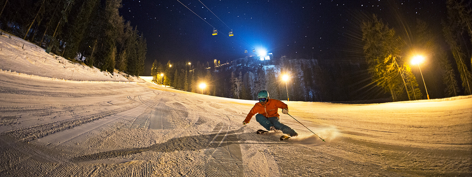 Perfectly groomed piste during night skiing on the Hochwurzen